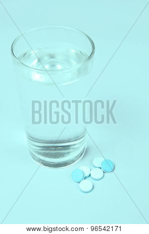 A Glass Of Water And Pills, Medicals, Drugs, Tablets In White