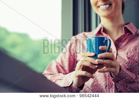Relaxing Coffee Break At Window