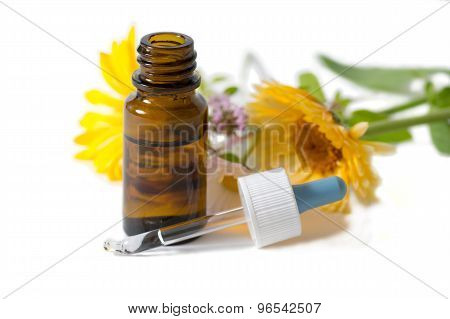 Bottle And Dropper With Calendula And Clower Flowers