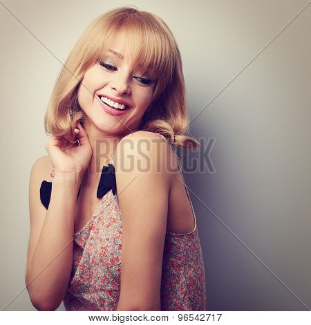 Relaxing Laughing Young Fashion Blond Woman With Short Hair Style Looking Down
