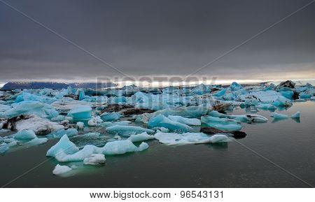 Dark clouds over a glacier lagoon