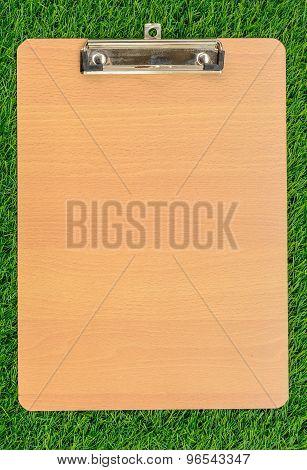 Wooden Clipboard On Green Grass