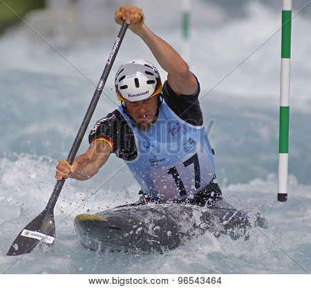 LONDON, ENGLAND - JUNE 06 2014 Nico Bettge of Germany competes at the ICF Canoe Slalom held at the Lea Valley White Water centre Waltham Abbey.
