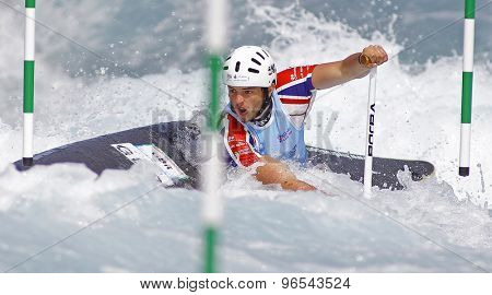 LONDON, ENGLAND - JUNE 06 2014 Ryan Westley of Great Britain competes at the ICF Canoe Slalom held at the Lea Valley White Water centre Waltham Abbey.