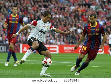 LONDON, ENGLAND. May 28 2011: Manchester's forward Javier Hernandez and Barcelona's midfielder Javier Mascherano during the 2011UEFA Champions League final between Manchester United and FC Barcelona