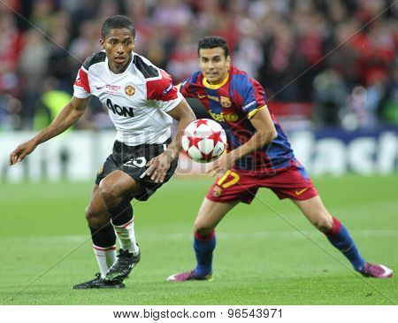 LONDON, ENGLAND. May 28 2011: Manchester's midfielder Antonio Valencia and Barcelona's midfielder Pedro Rodreguez during the 2011UEFA Champions League final between Manchester United and FC Barcelona