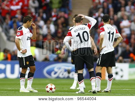 LONDON, ENGLAND. May 28 2011: United players during the 2011UEFA Champions League final between Manchester United and FC Barcelona, at Wembley Stadium