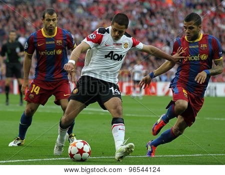 LONDON, ENGLAND. May 28 2011: Javier Mascherano, Manchester's Javier Hernandez and Barcelona's Daniel Alves during the 2011UEFA Champions League final between Manchester United and FC Barcelona