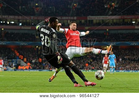 LONDON, ENGLAND - Nov 26 2013: Arsenal's Oliver Giroud attempts to intercept a kick by Marseille's Steve Mandanda  during the UEFA Champions League match between Arsenal and Olympique de Marseille