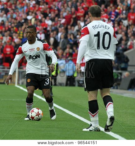 LONDON, ENGLAND. May 28 2011: Manchester's defender Patrice Evra and Manchester's forward Wayne Rooney during the 2011UEFA Champions League final between Manchester United and FC Barcelona