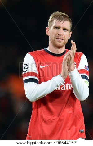 LONDON, ENGLAND - Nov 26 2013: Arsenal's Per Mertesacker during the UEFA Champions League match between Arsenal and Olympique de Marseille, at The Emirates Stadium