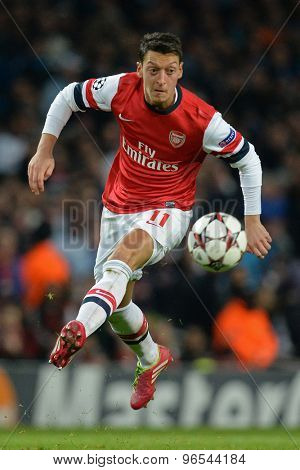 LONDON, ENGLAND - Nov 26 2013: Arsenal's Mesut Ozil during the UEFA Champions League match between Arsenal and Olympique de Marseille, at The Emirates Stadium