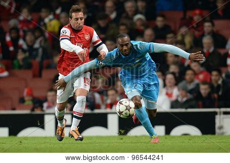 LONDON, ENGLAND - Nov 26 2013: Arsenal's Santi Cazorla and Marseille's Kassim Abdallah compete for the ball during the UEFA Champions League match between Arsenal and Olympique de Marseille
