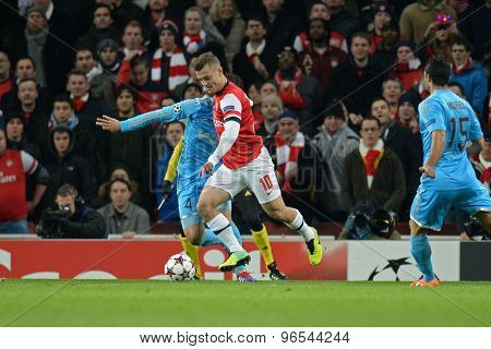 LONDON, ENGLAND - Nov 26 2013: Arsenal's Jack Wilshere scoring a goal during the UEFA Champions League match between Arsenal and Olympique de Marseille, at The Emirates Stadium