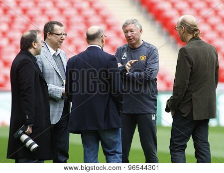 LONDON, ENGLAND. May 27 2011: Manchester's manager Sir Alex Ferguson the club owners from America The Glazer brothers during the official training session for the 2011UEFA Champions League final