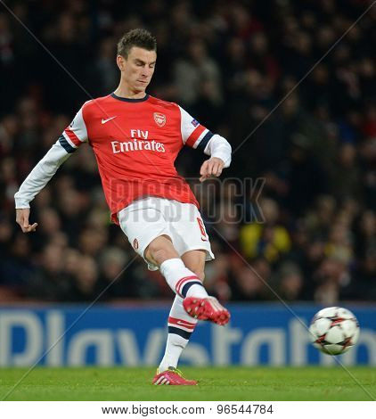 LONDON, ENGLAND - Nov 26 2013: Arsenal's Laurent Koscielny during the UEFA Champions League match between Arsenal and Olympique de Marseille, at The Emirates Stadium
