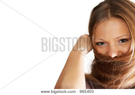 Young Woman Playing With Hair. Isolated.