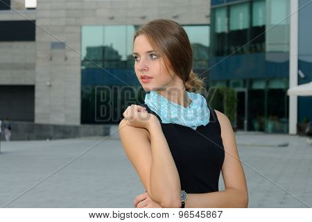 Woman Is Standing Against A Background Of Modern Building