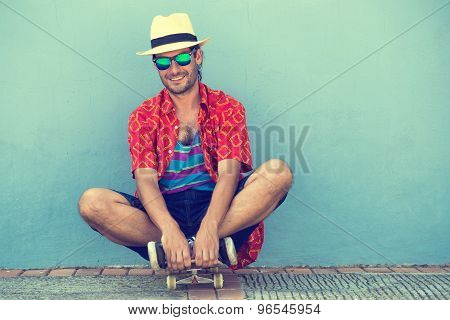 Man With Skateboard Wearing Tank Top And Shorts