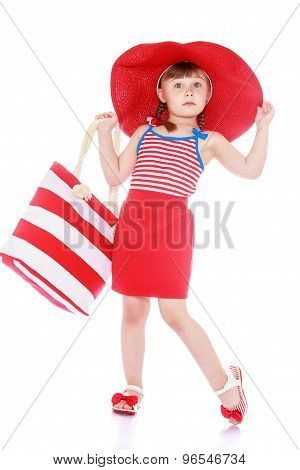 Fashionable little girl on the beach