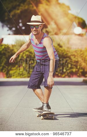 Man With Skateboard With Analog Effect Of Light Leakage