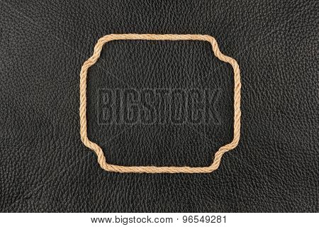 Figured Frame Made Of Rope Lying On The Natural Leather