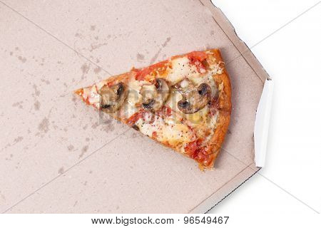 Slice of tasty pizza with vegetables in cardboard close up
