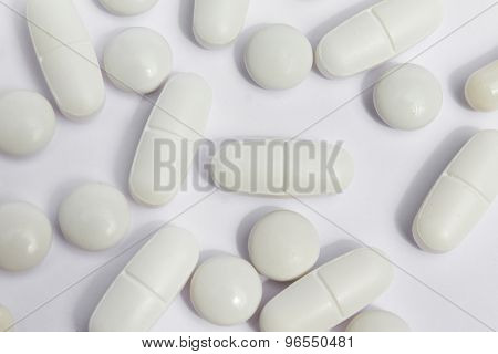 white pills /medicine / capsules close up on white background