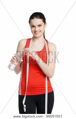 Healthy woman with a bottle of water