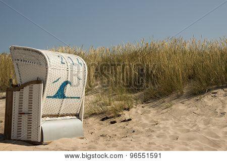 Beach chair on a dune