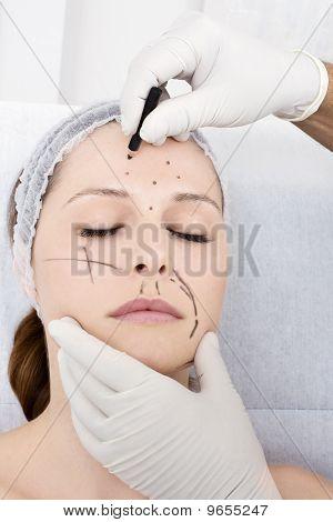 woman preparing for facial plastic surgery