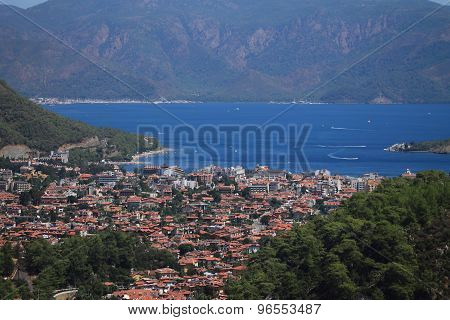 seascape,  village and harbor surrounded by mountains