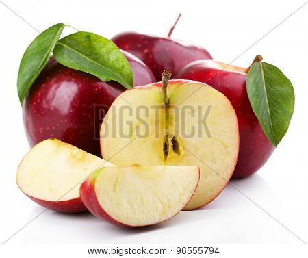 Red apples with leaves and slices isolated on white