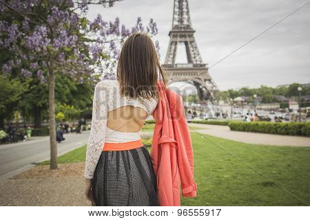 Romantic girl is looking at eifel tower