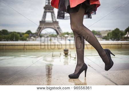 Romantic girl legs in healed shoes eifel tower Paris