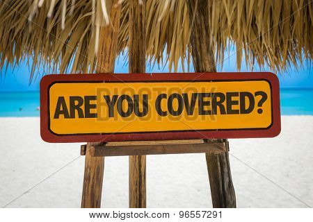 Are You Covered? sign with beach background