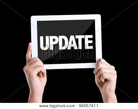 Tablet pc with text Update isolated on black background