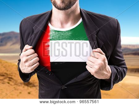Businessman stretching suit with United Arab Emirates with desert background