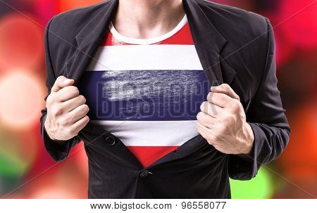 Businessman stretching suit with Thailand Flag with bokeh background