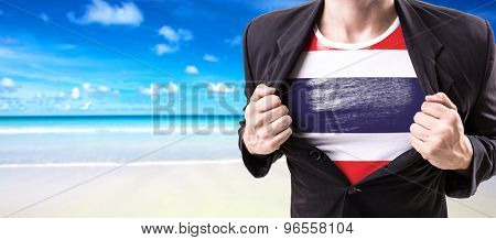 Businessman stretching suit with Thailand Flag with beach background