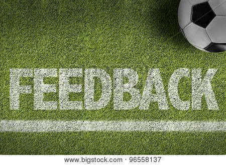 Soccer field with the text: Feedback