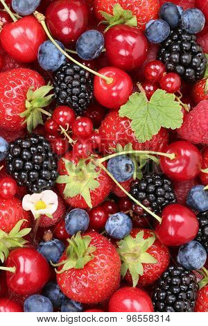 Berry Fruits Background With Strawberries, Raspberries And Cherries