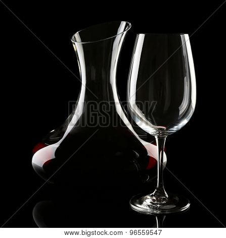 Glass carafe of wine on dark background