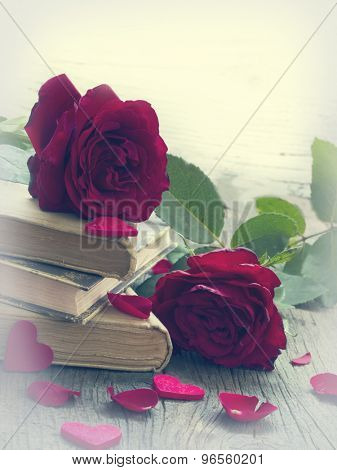 old books with red roses, vintage memories