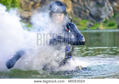 Woman Diver Cheking Her Gear.