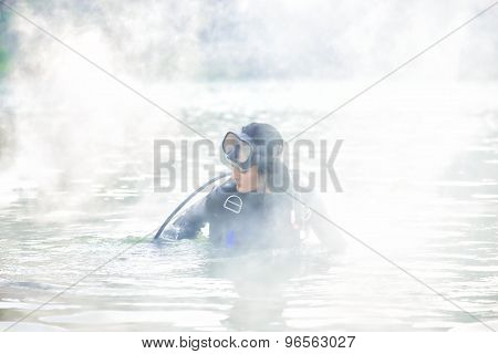 Woman Diver In Water Shrouded In Smoke