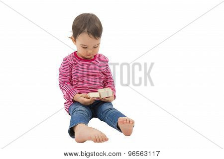 Little Cute Girl Opening A Gift Box, Isolated On The White Background