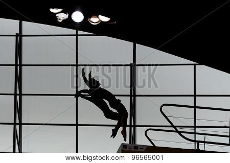 LONDON, GREAT BRITAIN - APRIL 25 2015: silhouette of divers competing in the men's synchro 10m platform during the FINA/NVC Diving World Series at the London Aquatics Centre