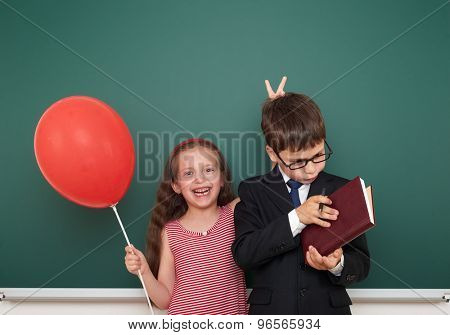 boy and girl near the school board