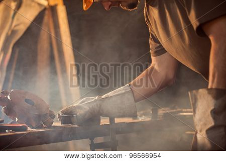 Close-up of worker in workshop with many tools